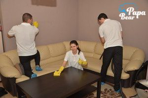End fo tenancy cleaners cleaning couch in a living room in Clapham